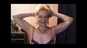 Nice old granny flexes her biceps on cam