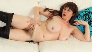 English milf Janey gets naughty in black..