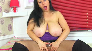 English milf Sabrina puts her big tits..