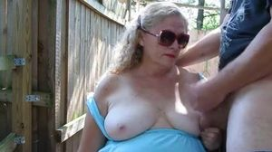 Mature couple garden play.mp4