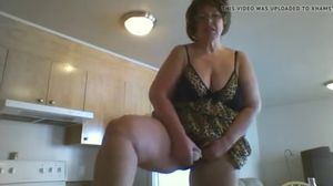 Mature BBW uses dildo while standing