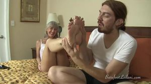Milf Gives Sensual Foot Job to Young..