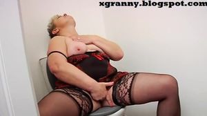 Horny mature solo in the toilet