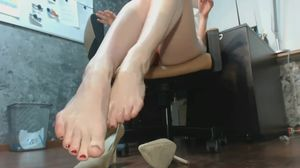Woman plays with her feet in her office